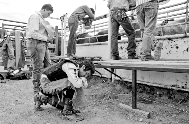 RODEO067.jpg Bullrider Patrick Hemken kneels to pray before the CPRA Rodeo at the Boulder County Fairgrounds on Sunday. Go to timescall.com for more photos. Matthew Jonas / Staff Photographer Aug. 2, 2015