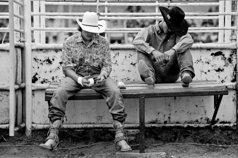 From left: Brian Brown and Tanner Butner get ready to ride before the start of the CPRA Rodeo at the Boulder County Fairgrounds on Sunday. Go to timescall.com for more photos. Matthew Jonas / Staff Photographer Aug. 2, 2015