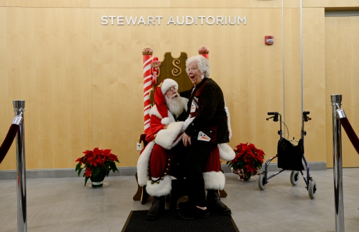 Lila Stewart and Santa Claus after Longmont Museum's First Holiday Festival at the Stewart Auditorium on Saturday. Matthew Jonas/Staff Photographer Dec. 19, 2015