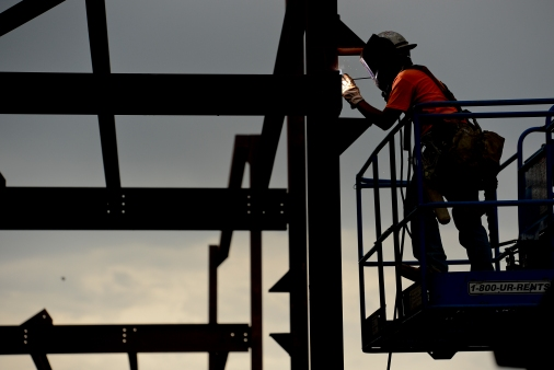 Levi Meade, of Starling Steel Services, welds a beam into place on a building at the Village at the Peaks in Longmont on Tuesday. Go to timescall.com for more photos. Matthew Jonas / Staff Photographer June 30, 2015
