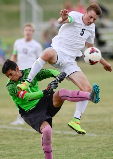 Niwot High School's Justin Barkow (No. 5) collides with Longmont High School's goal keeper Joel Chavez (No. 1) on Thursday. Go to timescall.com for more photos. Matthew Jonas / Staff Photographer Oct. 1, 2015