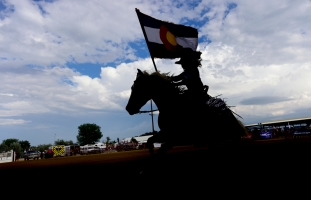 A rodeo queen carries the Colorado state flag to open the CPRA sanctioned rodeo on Sunday at the Boulder County Fair in Longmont. The rodeo featured nine events including bareback riding, steer wrestling, tie-down roping, breakaway roping, saddle bronco riding, mixed team roping, open team roping, ladies barrel racing and bull riding. More photos: timescall.com. Matthew Jonas/Times-Call July 30, 2017