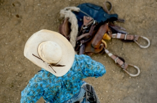 A saddle bronc rider waits behind the shoots during the CPRA sanctioned rodeo on Sunday at the Boulder County Fair in Longmont. The rodeo featured nine events including bareback riding, steer wrestling, tie-down roping, breakaway roping, saddle bronco riding, mixed team roping, open team roping, ladies barrel racing and bull riding. More photos: timescall.com. Matthew Jonas/Times-Call July 30, 2017