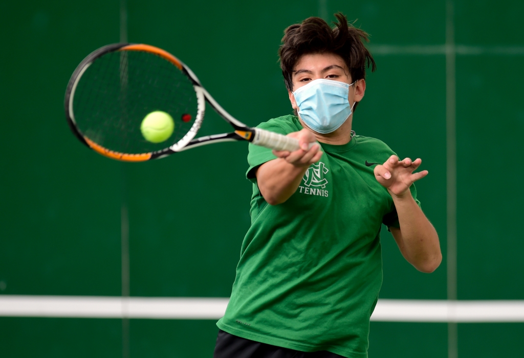 Masked Niwot Tennis Players